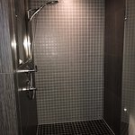 Large step in shower with dual shower heads