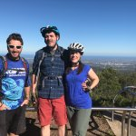 Our guide, Ian (left) and my husband and I at the lookout at the top of Mt Lofty.