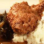 Springer Mountain Buttermilk Fried Chicken, white cheddar grits, pot likker collards