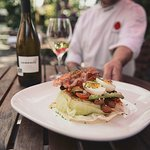 Chef Andy Moore holding our Lois Lake Steelhead Cobb Salad on our beautiful patio.