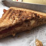 #28 Peanut butter, bacon and banana panini with honey on wheat.