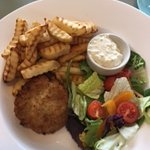 Fish cake with chips and salad.