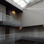 Luminous atrium is photogenic with daylight shining thoroug glass roof