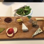 Tasty cheese board with lots of bread and delicious chutneys too