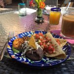 Quesadillas served with grilled zucchini and refried beans; freshly squeezed orange juice availa
