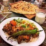 The grilled chicken with rice and a glass of ayran.