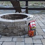 Firepit/patio. We were able to use our small grill there : )
