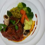Indian herbs braised lamb shank with crushed potato and vegetable..