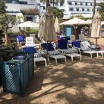 Part of pool area at 3.00 pm. Management allow towels to sunbathe solo all day! No attempt to en
