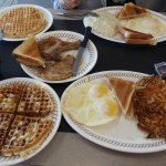 Pork Chop breakfast with pecan waffle and scattered and smothered heaven