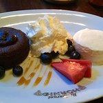 Chocolate cake, fresh whipped cream, berries and vanilla ice cream