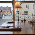 Cozy, streetside, rustic wooden table