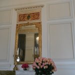 Flowers and a gorgeous mirror in the reception area