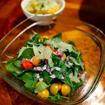 Salads prepared from pomelos, oranges, tomatoes, basil, arugula and kale all found on the proper