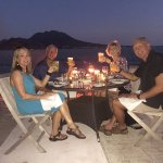 Enjoying a remarkable evening with dinner on the beach.