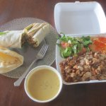 Takeout of chicken shawarma, lentil soup, and Al Basha plate.