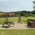 Looking across the garden to the cottages & BBQ