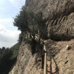 narrow path to caves on the cliffside where hermit to live