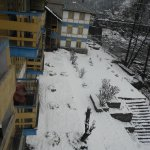 view from hotel room balcony after snowfall