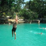 My husband using the swinging rope at the beautiful Blue Lagoon.