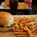 SCRUMPTIOUS BURGER WITH THEIR HOMEMADE TARTARE SUACE