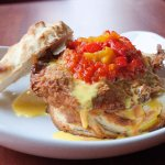 Chicken fried biscuit with red and yellow pepper pico de gallo and chipotle hollandaise