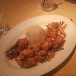 Chicken in orange sauce with rice and vegetables