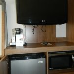microwave and refrigerator and coffee maker in each room