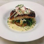 Cajun-grilled Bay of Fundy salmon is being served with a citrus creme and shrimp salad.