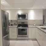 Fully accessorized modern kitchen - 2 bedroom condo