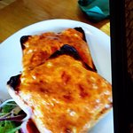 Burnt corners on the Welsh rarebit that took 40 minutes to do!! Outrageous.