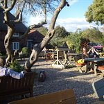 The Gribble Inn at Oving has a delightful Beer Garden with tables, chairs and umbrellas.