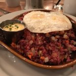 Corned beef hash with eggs optionally over medium and Hollandaise on the side