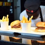 Our chef making sure the burgers are just perfect..