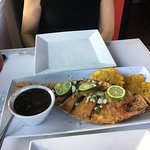 Whole fried fish, black beans and fried plantains, yum!