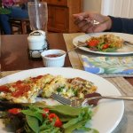 Scrambled eggs with sausage, brocoli, and other stuff, plus mesclun salad and tomatoes