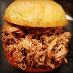 Authentic hand-pulled pork sandwich on brioche.  Sauce it yourself or enjoy it as is!