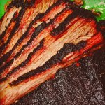Texas-stye Brisket.  Slow-smoked for up to 17 hours...