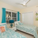 Modern comfortable guest room with Caribbean Decor