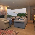 Lounge area with Fireplace & Sea facing deck