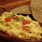 scrambled eggs with tomato and onions.
