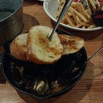 mussels came with toasted bread, fish tacos at the back came with fries