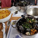 Lovely pot of moules with cream and a well-stocked bowl of delicious frites!