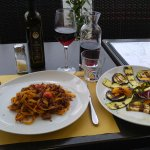Tagliatelle al ragu di cinghiale and grilled, seasonal vegetables.