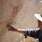 Guide Beto showing rock paintings.