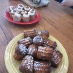 Canelés in the foreground and mini hummingbird cupcakes in the background