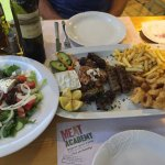 Lovely Meze selection, with greek salad and a bottle of Status 99 - a red wine serve chilled
