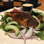 garden salad with blackened salmon on top