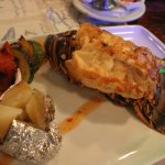 Lobster tails come with a potato and some veggies and butter.