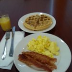 My choice: Waffle, scrambled eggs, bacon and orange juice.